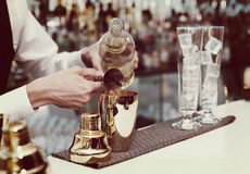 Bartender is making a cocktail, toned Stock Photography