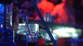 Bartender making cocktails, working in night club, serving beverages in pub. Stock footage stock video footage