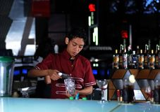 Bartender making drink Stock Images