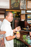 Bartender making mojitos at La Bodeguita del Medio in Havana Royalty Free Stock Image