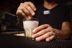 The bartender mixes a cocktail stick Lebowski. 2 Royalty Free Stock Photos