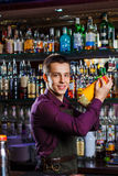 The bartender mixing cocktail Royalty Free Stock Image