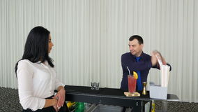 Bartender mixing cocktail shots drinks for woman waiting stock video