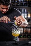 Bartender muddling lime Stock Photo
