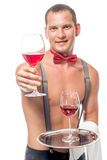 Bartender, with a naked torso gives a glass of ine Stock Photos
