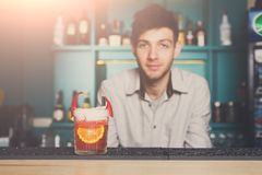 Bartender offers exotic spicy alcoholic cocktail Stock Image