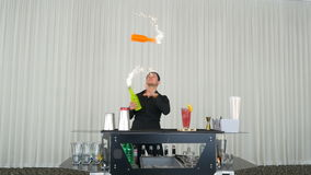 Bartender performing flair bartending with fireworks at party stock video
