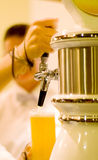 Bartender pouring beer. (shallow dof royalty free stock image