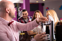 Bartender pouring beer Royalty Free Stock Image
