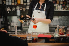 Bartender pouring champagne into glass, close-up Stock Photos