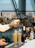 Bartender is pouring cocktail in glass Royalty Free Stock Photo