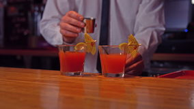 Bartender pouring cocktails on counter stock video footage