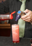 Bartender Pouring Drink Stock Photo