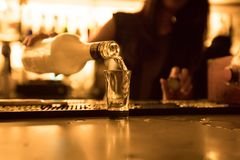 Bartender Pouring Shot Of Alcohol At The Bar Royalty Free Stock Images