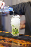 Bartender pouring soda in glass Royalty Free Stock Photos
