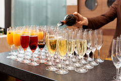 Bartender is pouring sparkling wine in glasses Royalty Free Stock Photography