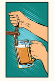 The bartender pours a glass of beer Stock Images