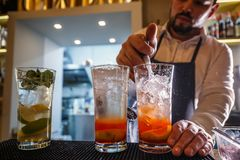 Bartender pours sparkling water Stock Images
