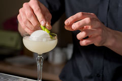 Bartender prepares a cocktail Royalty Free Stock Image
