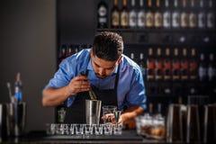 Bartender preparing an alcoholic beverage. In a restaurant bar Stock Photos