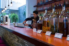 Bartender preparing a cocktail Stock Photo
