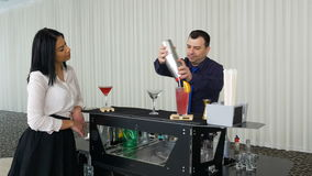 Bartender preparing cocktail for lady waiting by mobile bar stock video
