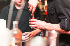 Bartender preparing a cocktail. Process of preparation. Nightlife stock photo
