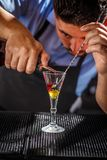 Bartender preparing layered cocktail Stock Photo