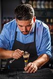 Bartender preparing layered cocktail Stock Photos