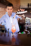 Bartender preparing Sex on the beach cocktail in an outdoor bar Stock Image
