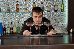 Bartender preparing three glasses of cocktail Stock Photography