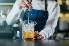 Bartender professionally working royalty free stock images