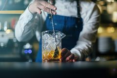 Bartender professionally working stock image
