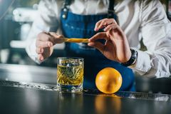 Bartender professionally working stock photo