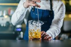 Bartender professionally working royalty free stock photos