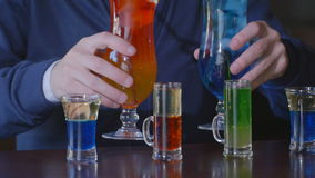 The bartender puts on the bar set of cocktails. stock video footage