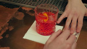 Bartender`s hand is giving out the prepared cocktail and visitor hand pay by cash stock footage