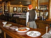 Bartender in saloon, waxworks, Alaska Royalty Free Stock Image