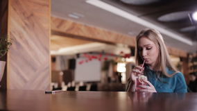 The bartender serves cocktails pretty girl sitting at the bar stock footage
