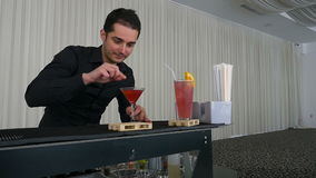 Bartender serving cocktail drink at a bar stock video footage