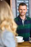 Bartender Serving Coffee To Woman At Cafe Stock Photos