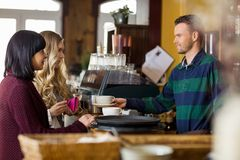 Bartender Serving Coffee To Women Royalty Free Stock Photos