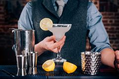 Bartender serving drinks at bar or pub. Cocktail, alcoholic beverages at bar with margarita ready to drink Stock Photo