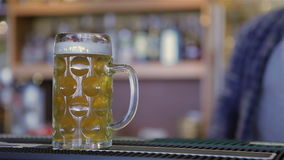 Bartender serving two glasses of beer stock video footage