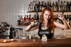 Bartender. Sexy redhead bartender with shaker Royalty Free Stock Images
