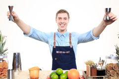 Bartender with a shaker and bottle on white Stock Image