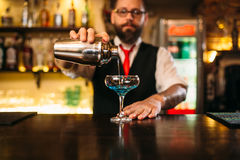 Bartender with shaker making alcohol cocktail Stock Photos