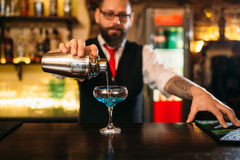 Bartender with shaker making alcohol cocktail Royalty Free Stock Photography