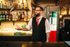 Bartender with shaker show professional trick Stock Images