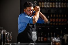 Bartender shakes and mixing Royalty Free Stock Photography